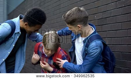 Cruel Teenagers Punching Younger Boy, Physical Intimidation, School Bullying