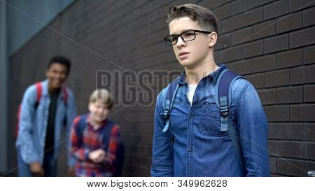 Evil Teens Mocking Boy In Eyeglasses, Spreading Malicious Rumors Verbal Bullying