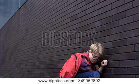 Scared Schoolboy Leaning Against Wall, Hiding From Bullying, Intimidation