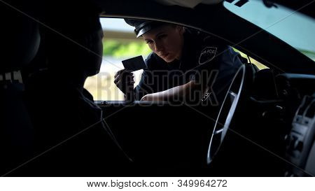 Police Woman Checking Documents Of Driver, Inspection On Road, Traffic Offence