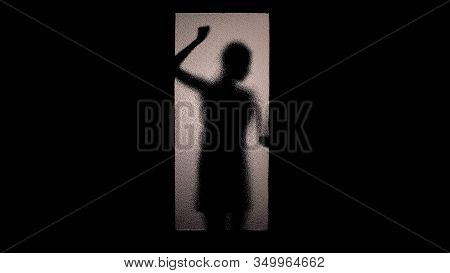 Scared Woman Shadow Knocking Glass Door With Fists, Checking Handle, Escape