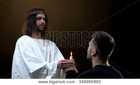 Messiah And Praying Man Holding Candle, Faith In God, Religious Hope, Blessing