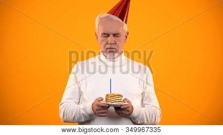 Upset Lonely Man Looking At Birthday Cake, Forgotten By Relatives, Solitude
