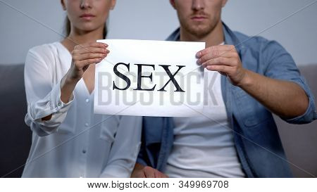 Upset Couple Holding Sex Word On Cardboard, Sexual Life Disorder, Problems