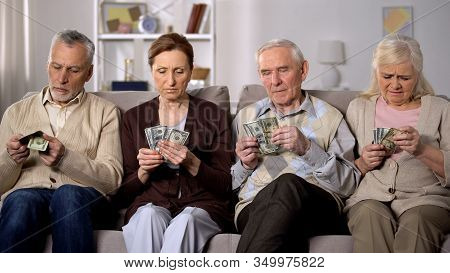 Poor Aged Couples Counting Dollars At Home, Lack Of Money, Social Insecurity