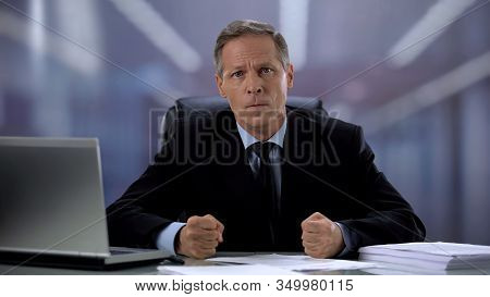 Angry Boss With Clenched Fists Looking At Camera, Failed Task, Material Losses