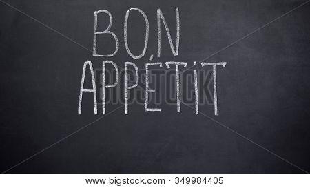 Bon Appetit Phrase Written On Blackboard, High-end Restaurant Advertisement