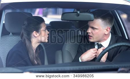 Husband And Wife Quarreling In Auto, Misunderstanding In Relations, Breakup Risk