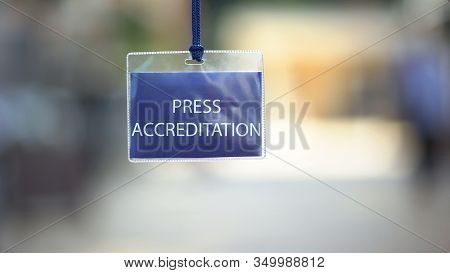 Press Accreditation Pass Against Blurred Background, Media Id Card During Event