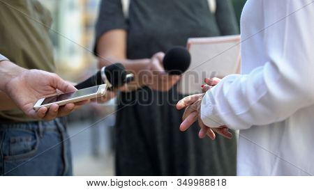 Woman Gesticulating During Interview With Media, Press Conference, Close-up