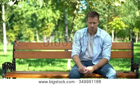 Sad Young Man Sitting Alone Park Bench, Breakup Crisis, Problem Hopelessness