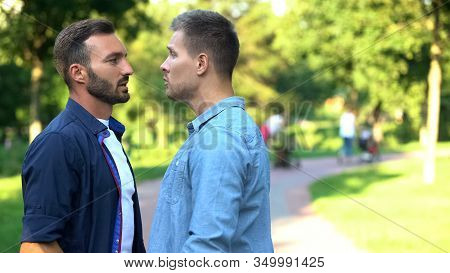 Aggressive Young Males Looking Each Other Outdoors, Communication Conflict