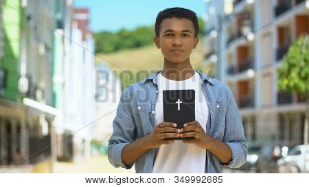 Teen Male Christian Holding Holy Bible Near Heart, Faith And Belief, Religion
