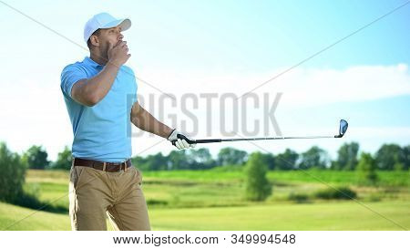 Young Male Golf Player Hitting Ball, Surprised With Unsuccessful Shot, Bad Luck