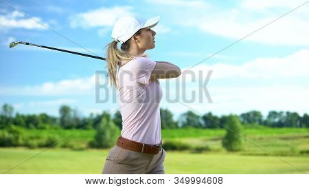 Woman Playing Golf In Backswing Position, Upset About Failed Shot, Loser Concept