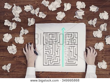 Shortcut Of A Maze Drawn On Paper . Crumpled Papers Arround. Easy Solution Of A Difficult Problem.