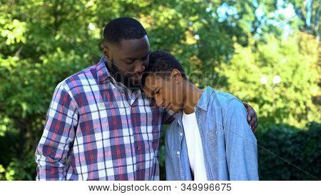 Kind Father Hugging Teenage Son Admitting Guilt, Child Upbringing, Parenting
