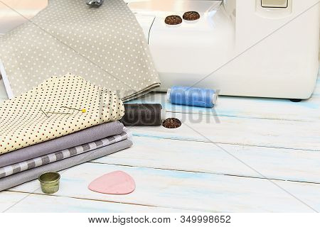 Sewing Tools And Fabric On A White Machine Background. Concept For Needlework, Stiching, Embroidery