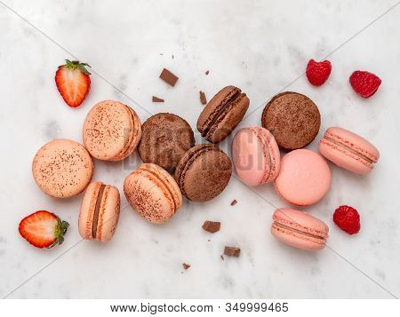 Composition With French Macarons On White Marble Background. Top View Of Colorful Pastel Macaroons O