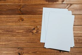 White Paper On Wood Background And Shadow