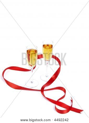 Two Wine Glasses And Red Satiny Tape