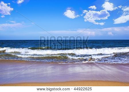 Beautiful beach below the bright blue sky