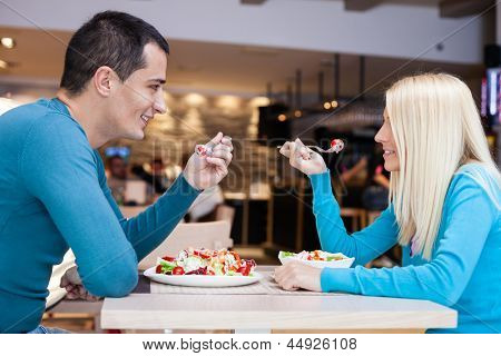 Young affectionate couple together on lunch at restaurant