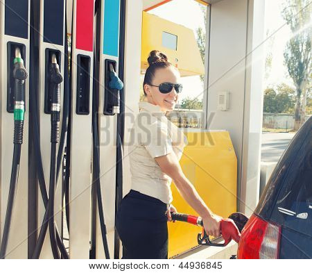 Beautiful Happy Woman At Old Fashioned Gas Station