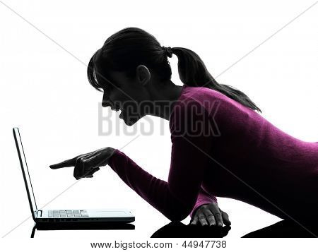one caucasian woman mouth open pointing computing laptop computer  in silhouette studio isolated on white background