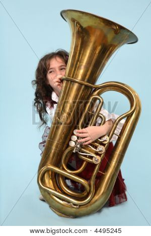 Young Girl Playing The Horn