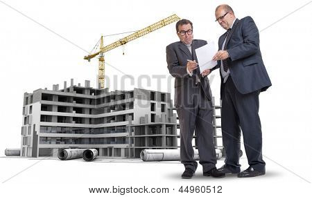 Two men in a dubious business deal by a building under construction