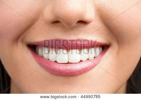 Extreme Close Up Of Female Smile.