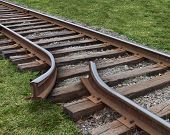Strategy obstruction challenges with a train track that is broken as a business concept of a road block and finding solutions to obstacles that are dangerous and challenging as journey on a strategic goal. poster