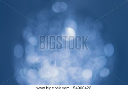 White natural bokeh on blue background