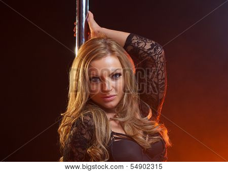 Portrait Of A Sultry Female Pole Dancer