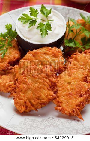 Latkes, hebrew potato pancakes served with sour cream