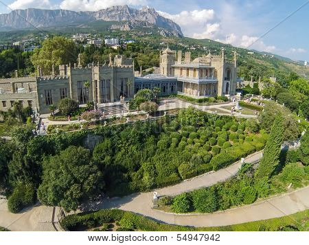 YALTA - AUG 27: Beautiful Vorontsov Palace with green garden in front, against the sky and mountain Ay Petri on August 27, 2013 in Yalta, Ukraine. View from unmanned quadrocopter.