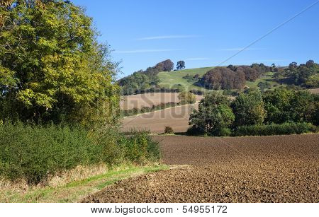 Farmland at Meon Hill near the Cotswold village of Mickleton, Gloucestershire, England. poster
