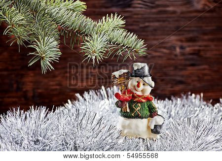 Christmas Decorations. Happy Snowman, Fir-tree, Tinsel On Wooden Background. Selective Focus