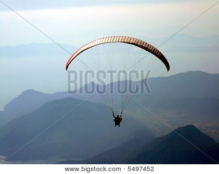 Paraglider Over The Mountains