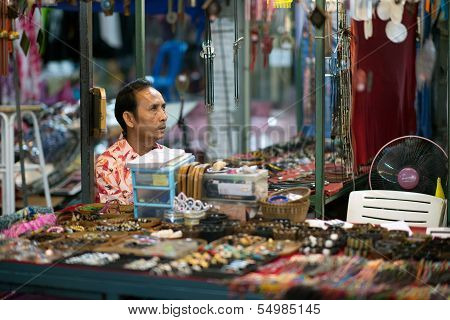 Thai salesman waiting for customers at the night market