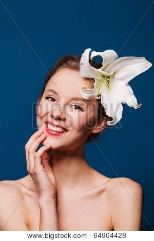 beauty portrait of a beautiful woman with fresh flower lily