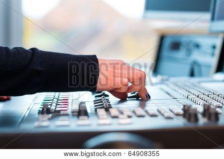 Presenter in radio station hosting show for radio live in Studio
