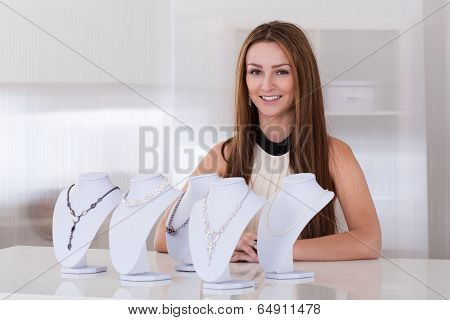 Young Woman Working In Jewelry Shop