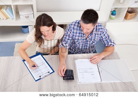 Couple Calculating Bills