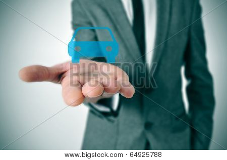 a businessman with a car icon in his hand