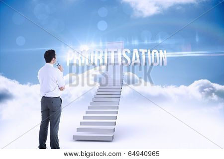 The word prioritisation and businessman holding glasses against shut door at top of stairs in the sky