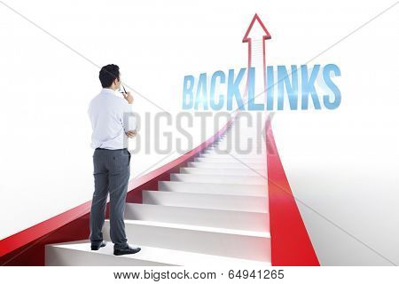 The word backlinks and businessman holding glasses against red arrow with steps graphic