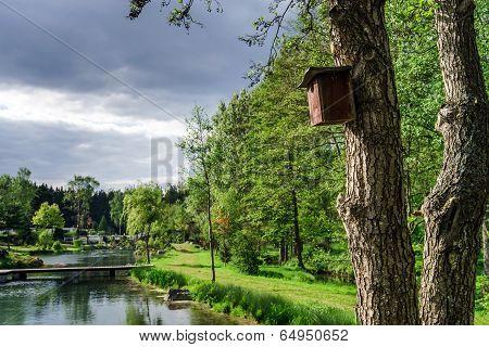 Wooden Bird House On A Tree