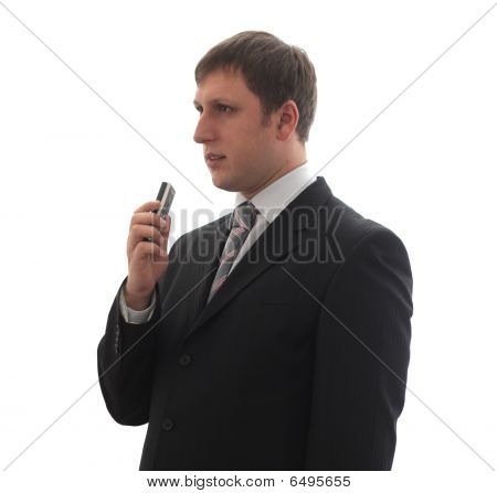A Man In A Suit Says In A Digital Voice Recorder.